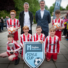 Star attraction: .West Brom and Republic of Ireland ace James McClean joins Don Brennan of Hughes Insurance and Derry Colts players at the launch of the Foyle Cup last night