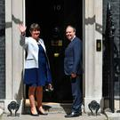 Democratic Unionist Party (DUP) leader Arlene Foster (L), and DUP Deputy Leader Nigel Dodds arrive at 10 Downing Street in central London on June 13, 2017, for a meeting with Britain's Prime Minister and Conservative Party leader Theresa May. British Prime Minister Theresa May on Tuesday was heading into difficult talks with the DUP on securing a working majority after a crushing electoral setback. / AFP PHOTO / Ben STANSALLBEN STANSALL/AFP/Getty Images