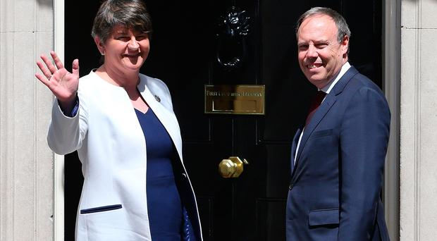 DUP leader Arlene Foster and MP Nigel Dodds arrive at 10 Downing Street on June 13, 2017 in London, England. (Photo by Jack Taylor/Getty Images)