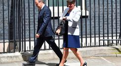 Democratic Unionist Party (DUP) leader Arlene Foster (R), and DUP Deputy Leader Nigel Dodds arrive at 10 Downing Street in central London on June 13, 2017, for a meeting with Britain's Prime Minister and Conservative Party leader Theresa May. British Prime Minister Theresa May on Tuesday was heading into difficult talks with the DUP on securing a working majority after a crushing electoral setback. / AFP PHOTO / Ben STANSALLBEN STANSALL/AFP/Getty Images