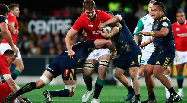 Iain Henderson is wrapped up by the Highlanders defence.