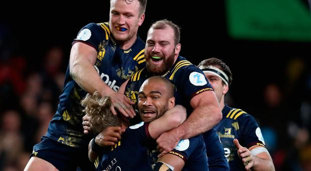 The Highlanders celebrate by attempting to form some sort of human pyramid. When you beat the Lions, you do whatever you want.