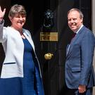 DUP leader Arlene Foster and DUP deputy leader Nigel Dodds arriving at 10 Downing Street in London for talks on a deal to prop up a Tory minority administration. PA