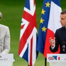 French President Emmanuel Macron and Prime Minister Theresa May speak at a joint press conference at the Elysee Palace during her visit to Paris, France. PA