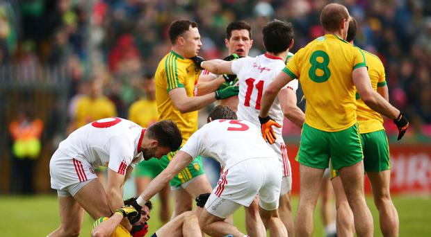 HOT SPOT: Tyrone's Tiernan McCann, Ronan McNamee and Donegal's Odhran Mac Niallais square up. Photo: Cathal Noonan/INPHO