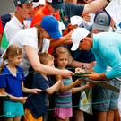 Sign of the times: Rory McIlroy signs autographs during a practice round prior to the 2017 US Open at Erin Hills. Photo: Gregory Shamus/Getty Images