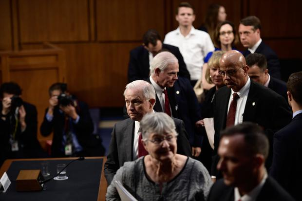 Attorney General Jeff Sessions leaves with his wife Mary Sessions (foreground) after testifying during a US Senate Select Committee on Intelligence hearing on Capitol Hill in Washington, DC, June 13, 2017. US Attorney General Jeff Sessions vehemently denied Tuesday that he colluded with an alleged Russian bid to tilt the 2016 presidential election in Donald Trump's favor. / AFP PHOTO / Brendan SmialowskiBRENDAN SMIALOWSKI/AFP/Getty Images