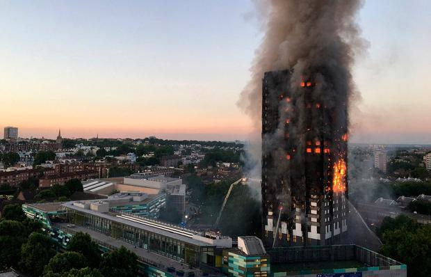 Image received by local resident Natalie Oxford early on June 14, 2017 shows flames and smoke coming from a 27-storey block of flats after a fire broke out in west London.AFP/Getty Images