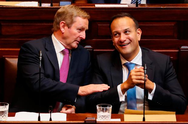 Ireland's former leader of Fine Gael, and outgoing Prime Minister Enda Kenny (L) talks with the party's newly elected leader, Leo Varadkar, during a session of the upper and lower housesof the Irish parliament to elect Varadkar as Ireland's new Prime Minister. AFP/Getty Images