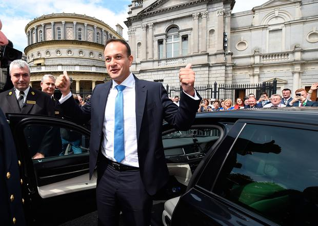 DUBLIN, IRELAND - JUNE 14: New Irish Taoiseach Leo Varadkar waves to TD's and well wishers at Leinster House after being elected as Taoiseach on June 14, 2017 in Dublin, Ireland. A vote in the Dail today confirmed Mr Varadkar as Ireland's youngest Taoiseach at the age of 38 and also its first gay leader. Mr Varadkar replaces Enda Kenny as both Fine Gael leader and outgoing Taoiseach after Mr Kenny stepped down yesterday. (Photo by Charles McQuillan/Getty Images)