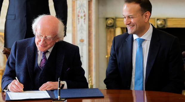 Ireland's President, Michael Higgins (L), greets Ireland's newly elected Prime Minister, and leader of the Fine Gael party, Leo Varadkar, at Aras an Uachtarain, the official residence of the Irish President, in Dublin, Ireland on June 14, 2017. AFP/Getty Images