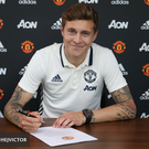 Done deal: Victor Lindelof signs for Man United