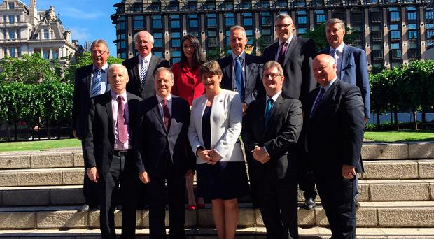 DUP leader Arlene Foster with the party's 10 MPs outside the Houses of Parliament in London earlier this week