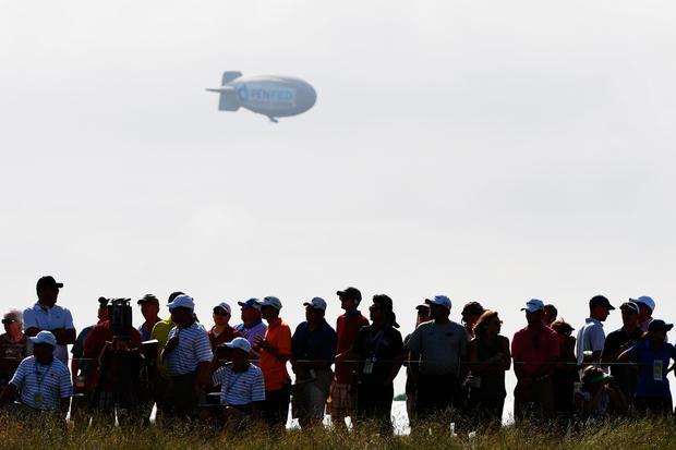 A blimp floats over the crowd during the first round of the 2017 U.S. Open at Erin Hills on June 15, 2017 in Hartford, Wisconsin. (Photo by Ross Kinnaird/Getty Images)