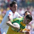Thick of it: Tyrone's Aidan McCrory and Ryan McHugh of Donegal