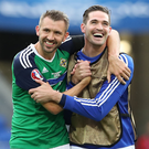 Northern Ireland's Gareth McAuley and Kyle Lafferty celebrate at the final whistle after defeating Ukraine during Euro 2016 at the Stade de Lyon, France.