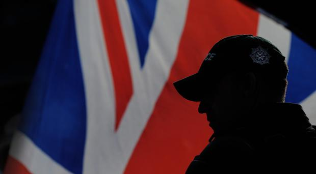 Loyalist paramilitaries are forcing police officers out of their homes.