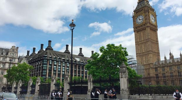 Police detain a man outside the Palace of Westminster, London. PRESS ASSOCIATION Photo.