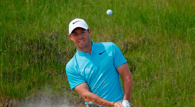 Up and down: Rory McIlroy struggles on his way out of the US Open