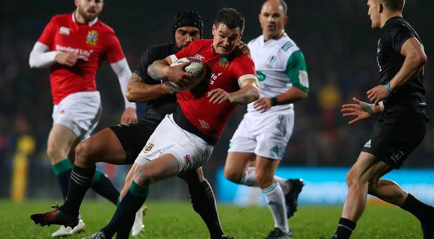 ROTORUA, NEW ZEALAND - JUNE 17: Johnny Sexton of the Lions is wrapped up by Charlie Ngatai of the Maori All Blacks during the 2017 British & Irish Lions tour match between the Maori All Blacks and the British & Irish Lions at the Rotorua International Stadium on June 17, 2017 in Rotorua, New Zealand. (Photo by David Rogers/Getty Images)