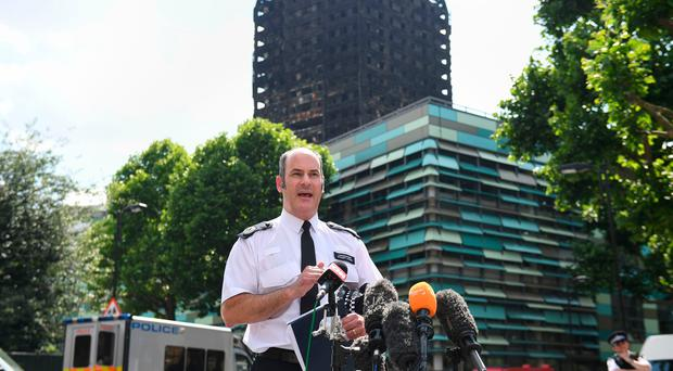 Metropolitan Police Commander Stuart Cundy speaking to the media near Grenfell Tower in west London. Pic Victoria Jones/PA Wire