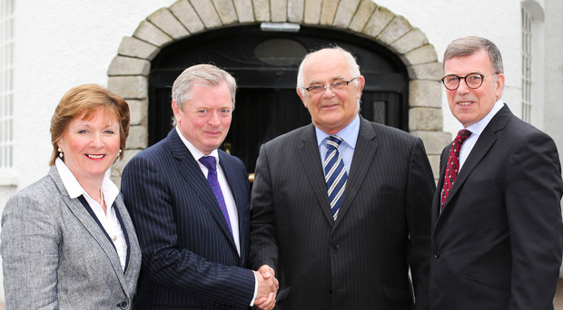 From left Catherine Eugene McKeever Felix Mooney and John Mooney as the Mooney Group hand over the Dunadry Hotel