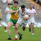 He's gone: Tyrone's Sean Cavanagh breaks past Donegal's Kieran Gillespie. Photo: John McIlwaine - Presseye