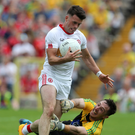 Tyrone's Darren McCurry skips past Donegal goalkeeper Mark Anthony McGinley. Photo: John McIlwaine/Press Eye