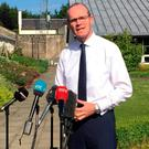 Irish foreign minister Simon Coveney speaking to media at Stormont Castle, Belfast David Young/PA Wire