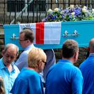 The coffin of Olivia Campbell-Hardy arrives at the Church of St Anne, Tottington