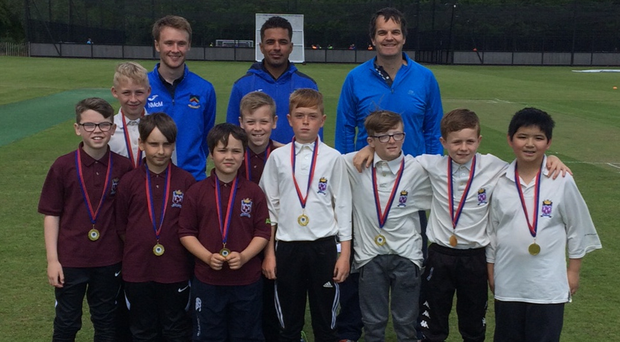 Young talent: Ralph Coetzee (back right) with fellow coaches Mansoor Amjad and Nicky McMinn and pupils from Brooklands Primary School