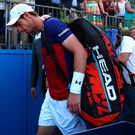 Early exit: Andy Murray leaves the court after crashing out of the Aegon Championships at Queens