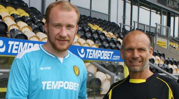 Gone south: Liam Boyce receives a warm welcome from Burton's assistant manager Gary Crosby after completing his transfer from Ross County