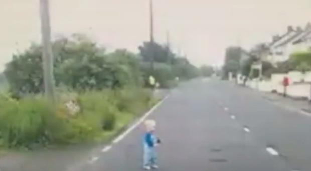 The tiny tot wandering out on to the road in front of a horrified motorist.
