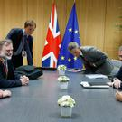 European Council President Donald Tusk, right, meets with British Prime Minister Theresa May, left, during a bilateral meeting on the sidelines of an EU summit in Brussels on Thursday, June 22, 2017. European Union leaders are gathering for a two day summit to weigh measures in which to tackle terrorism and migration and to create closer defense ties. (Francois Lenoir, Pool Photo via AP)