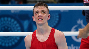 SORE: Brendan Irvine looks dejected after losing against Bator Sagaluev on a split decision. Photo: Ryan Byrne/INPHO