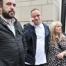 Aaron Harbinson (centre), son of John Harbinson, a victim of Gary Haggarty leaves court in tears following killer's guilty pleas