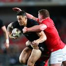 Sonny Bill Williams of the All Blacks tries to break clear