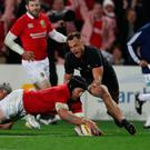 Sean O'Brien of the Lions dives over to score his team's first try