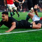 Rieko Loane of the All Blacks dives over to score his team's second try and ram home the hosts' advantage.