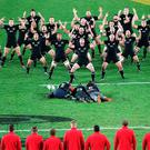 The British and Irish Lions come face to face with the All Black's haka - with a few photographers caught in no man's land.