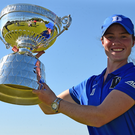 Leading lady: Leona Maguire shows off Ladies British Open Amateur Championship trophy