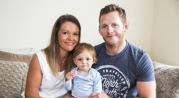 Child's play: Neil McTeggart with his wife Jennifer and daughter Alex