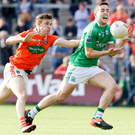 Man on: Armagh's Paul Hughes pursues Ryan Lyons
