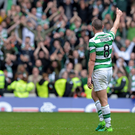 Lively encounter: Celtic captain Scott Brown salutes the club's faithful fans. Brown's team are facing a possible trip to Belfast to play Linfield in a Champions League qualifier next month
