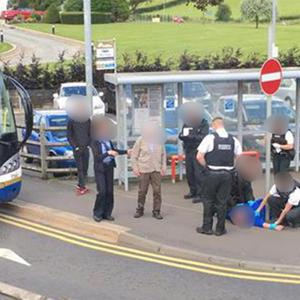 Police at the bus stop in Castledawson after a number of passengers were assaulted on the Belfast to Derry service