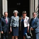 Prime Minister Theresa May greets DUP leader Arlene Foster, DUP deputy leader Nigel Dodds and MP Sir Jeffrey Donaldson outside 10 Downing Street in London ahead of talks aimed at finalising a deal to prop up the minority Conservative Government. Dominic Lipinski/PA Wire