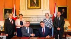 Theresa May with Secretary of State Damian Green, DUP leader Arlene Foster, DUP Deputy Leader Nigel Dodds, as MP Jeffrey Donaldson shakes hands with Chief Whip, Gavin Williamson, inside 10 Downing Street in central London on June 26, 2017.