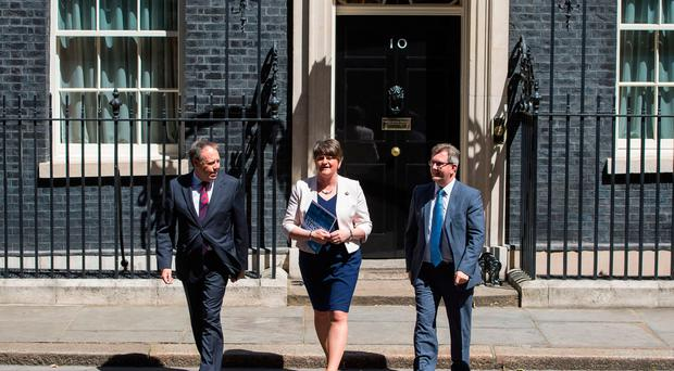 DUP leader Arlene Foster, DUP deputy leader Nigel Dodds (left) and MP Sir Jeffrey Donaldson leave 10 Downing Street in London after the party agreed a deal to support the minority Conservative government. Dominic Lipinski/PA Wire