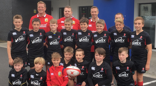 Ready to roar: The mini Lions, made up of young players from Coleraine, CIYMS and Ballymena, with their coaches